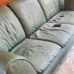 Photo of stained, faded Natuzzi leather couch