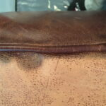 Image of 18 year old leather cushion before restoration