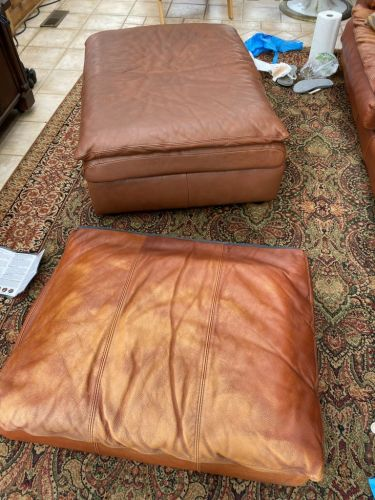 Photo contrasting discolored leather cushion and ottoman after Rust Rub n Restore