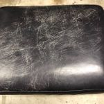 Picture of scratched leather ottoman