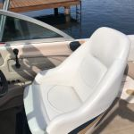 Boat seat vinyl restored with marine white dye.