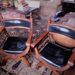 Two black leather chairs