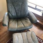 Picture of worn, green Ekornes leather chair and foot stool
