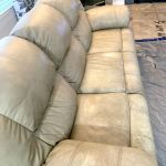 Picture of dirty, discolored leather couch