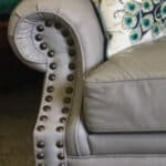 Picture of decorative brass tacks or nails on leather furniture