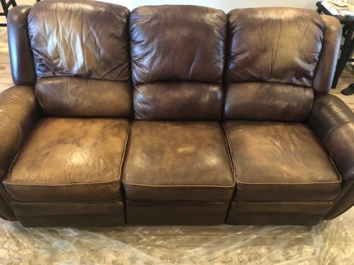 Picture of worn brown leather couch