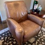 Picture of leather chair with oil stain and tear