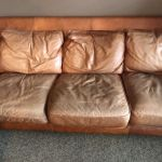 Worn, faded leather couch before Rub n Restore