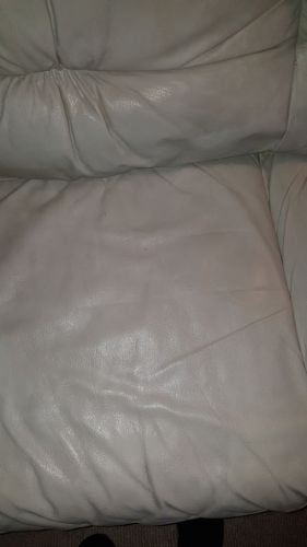 Picture of scratched leather couch restored with Ivory Rub n Restore