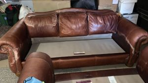 Picture of leather couch damaged by mineral deposits